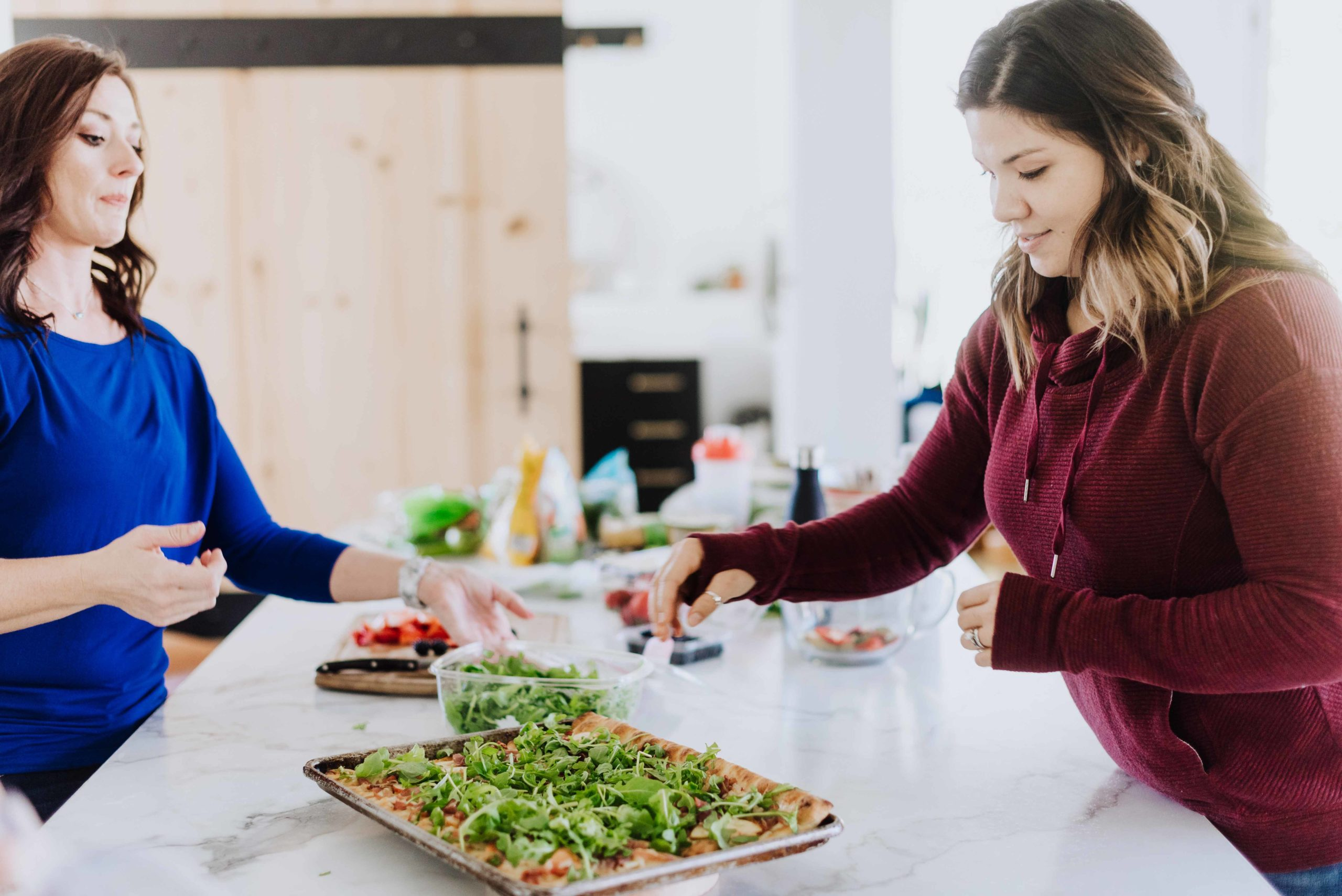 online nutrition coaching where client and nutrition coach work together to make a healthy meal